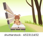 open book and bear toy on bench ... | Shutterstock .eps vector #652311652