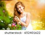 beauty girl outdoors enjoying... | Shutterstock . vector #652401622