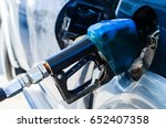 add fuel oil to the car in the... | Shutterstock . vector #652407358