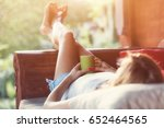 girl drinking coffee   tea and... | Shutterstock . vector #652464565