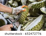 a man with knife is peeling the ... | Shutterstock . vector #652472776