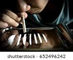 junkie is snorting cocaine...   Shutterstock . vector #652496242
