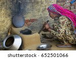 a rural woman blowing into a...   Shutterstock . vector #652501066