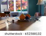 a glass of wine and a plate of... | Shutterstock . vector #652588132