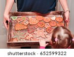 little girl looking at tray... | Shutterstock . vector #652599322