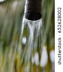 Small photo of Rainwater harvesting during monsoon - long exposure image. Water from the roof is collected via a PVC pipe.