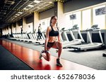 slim woman doing exercise with... | Shutterstock . vector #652678036