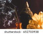Burning Incense Sticks With...