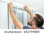 young man installing window... | Shutterstock . vector #652759885