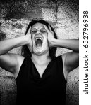 hysterical woman screaming in... | Shutterstock . vector #652796938