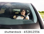 woman driving car anxiously.... | Shutterstock . vector #652812556