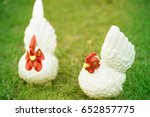 two chickens statue on green... | Shutterstock . vector #652857775