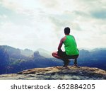 tourist in green singlet and... | Shutterstock . vector #652884205