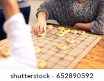 people playing chinese chess in ... | Shutterstock . vector #652890592