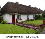 Typical Thatched Roof House in Ireland - stock photo