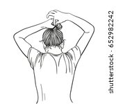 girl tie her hair in bun with... | Shutterstock .eps vector #652982242