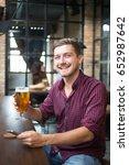 happy man holding smartphone... | Shutterstock . vector #652987642