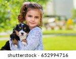 little girl with a berner... | Shutterstock . vector #652994716