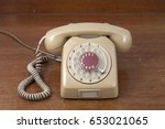 retro telephone on wood table  | Shutterstock . vector #653021065