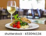 seared salmon fillet with wine... | Shutterstock . vector #653046136