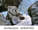 a little bird over a rock  | Shutterstock . vector #653047402