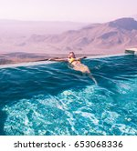 the girl in the pool amid a... | Shutterstock . vector #653068336