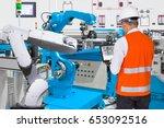 engineer using laptop computer... | Shutterstock . vector #653092516