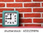 Green Clock On A Brick Wall...