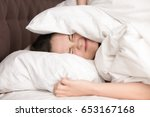 woman lying in bed covering... | Shutterstock . vector #653167168