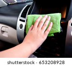 hand with microfiber cloth...   Shutterstock . vector #653208928