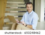 shot of a smiling casual man... | Shutterstock . vector #653248462