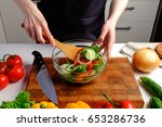 woman cooking mixing fresh... | Shutterstock . vector #653286736