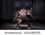 crossfit lifting bar by woman... | Shutterstock . vector #653290555