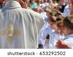 priest with parents and... | Shutterstock . vector #653292502