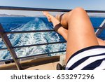 sexy young woman legs relaxing... | Shutterstock . vector #653297296