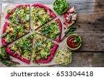 vegetarian red pizza. beetroot... | Shutterstock . vector #653304418