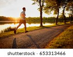 young man jogging in park... | Shutterstock . vector #653313466