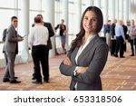 happy business woman standing... | Shutterstock . vector #653318506