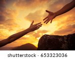 giving a helping hand and team... | Shutterstock . vector #653323036