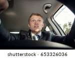 Small photo of Aggressive driver behind the wheel of a car