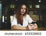 pensive redhead young woman... | Shutterstock . vector #653328802