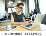 hipster woman use laptop huge... | Shutterstock . vector #653334502