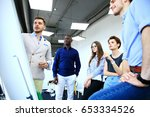 manager leading creative... | Shutterstock . vector #653334526