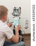 a boy and a robot assembled... | Shutterstock . vector #653339332