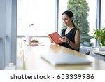 smiling prosperous editor... | Shutterstock . vector #653339986