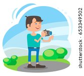the video blogger in the park... | Shutterstock .eps vector #653349502