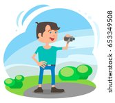 the video blogger in the park... | Shutterstock .eps vector #653349508
