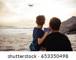 rear view of father and son... | Shutterstock . vector #653350498