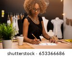 a young fashion designer... | Shutterstock . vector #653366686
