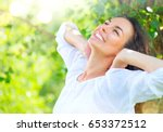 beautiful young woman enjoying... | Shutterstock . vector #653372512